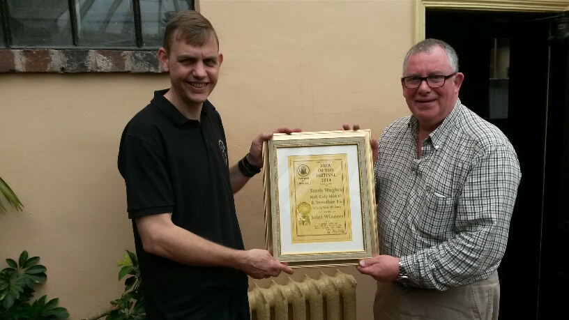 Branch Chair Rob Wells presents Simon Massetts of Sarah Hughes Brewery with the certificate marking the joint win by Dark Ruby Mild (6%) and Snowflake (8%).